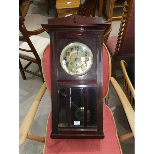 69 - A mahogany cased wall clock with brass dial and bevelled glass...