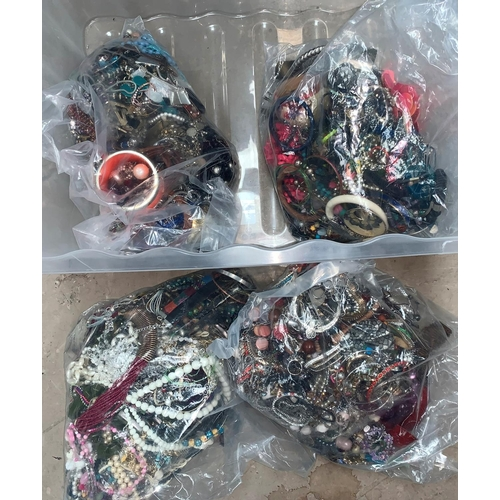 79 - a large selection of unsorted modern costume jewellery in 4 sealed bags...