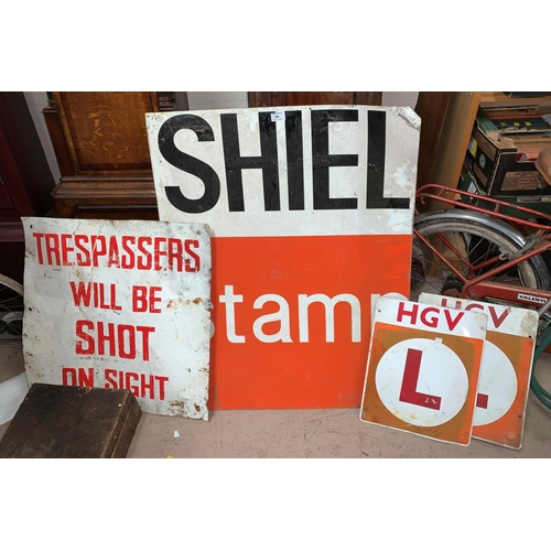 64 - A 'Shell Stamp' metal sign; 2 HGV 'L' plates; a sign 'Trespassers will be shot'...