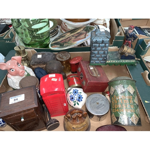 84 - A selection of novelty money boxes including a cast iron 'Artillery Bank' example...