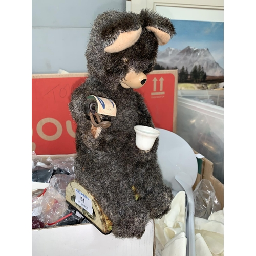 51 - A vintage battery operated bear drinking Pepsi Cola; a selection of dolls clothing accessories and b...