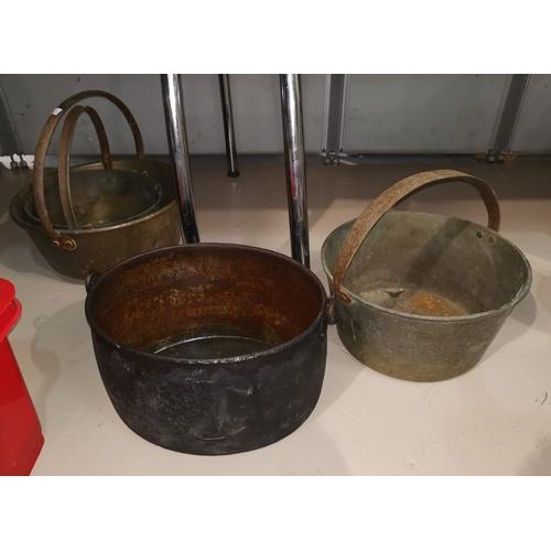 62 - Three 19th century jam pans; an oval pan...