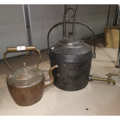 63 - A 19th century copper kettle; a large 19th century cast iron kettle;...