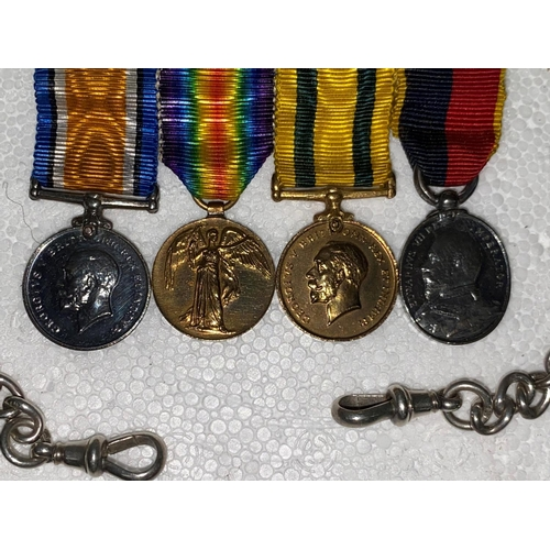 234 - A group fo 4 miniture medals including 2 Territorial Force medals awarded to sergeant Major D E BUCK...