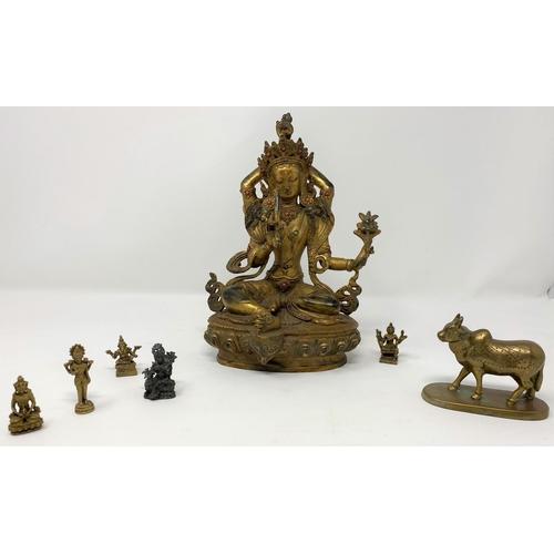 308 - A gilt figure of a Tibetan Buddha, ht 23cm; other similar miniature figures...