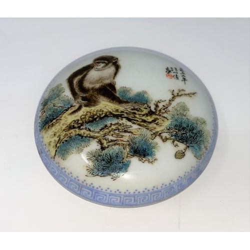 361B - A Chinese porcelain lidded pot decorated with a monkey, mark to base, d 10.5cm...