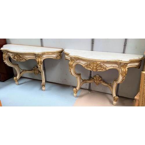 565 - A pair of 19th century console tables in the Rococco manner with scroll and accanthus supports in cr...