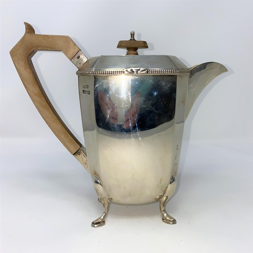 435 - An Art Deco hall marked silver coffee set of canted rectangular tapering design with beaded rim and ...