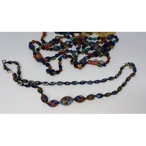 397 - A selection of bead necklaces including foil flecked beads, mille fiori etc
