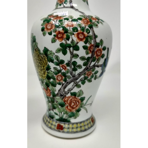 260a - A Chinese inverted baluster vase with slender neck, decorated in Imari palette, 6 character signatur...
