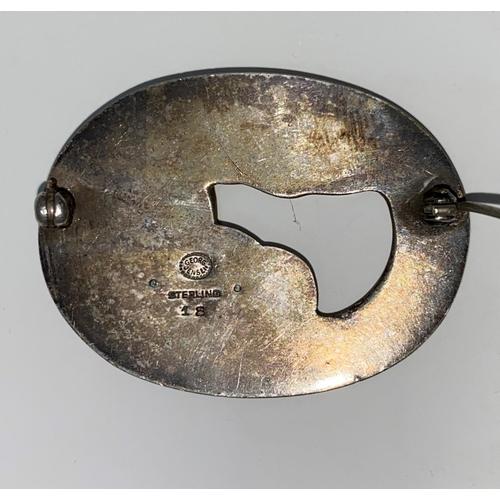 288 - A Georg Jensen Danish silver oval brooch of stylized leaf and brooch design, stamped Georg Jensen in...