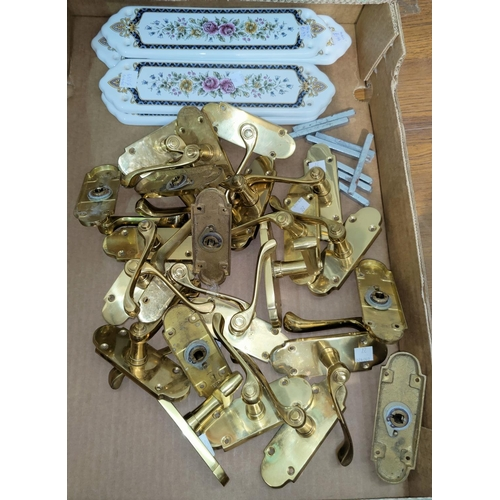 27 - A selection of brass door handles; 5 ceramic finger plates...