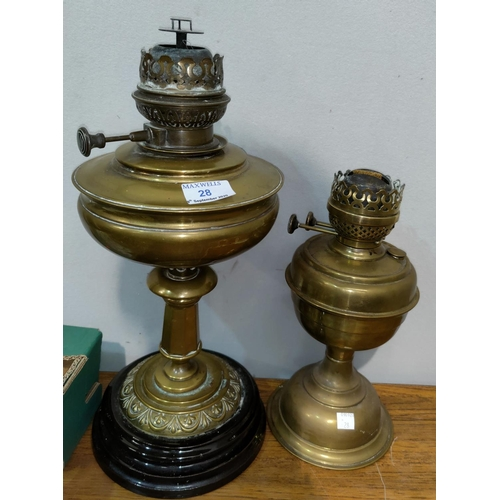 28 - Two brass oil lamps...