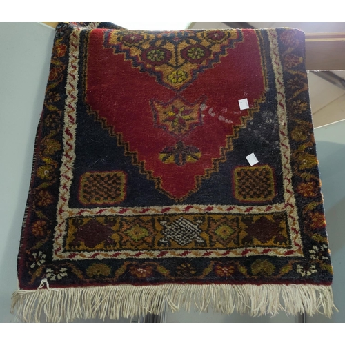 7 - 3 stoneware flagons and a jar; a small handknotted Persian rug...