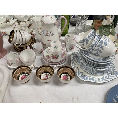 229 - A Shelley 14 piece part coffee set decorated with bunches of flowers; a Paragon coffee sets of 6 cup...