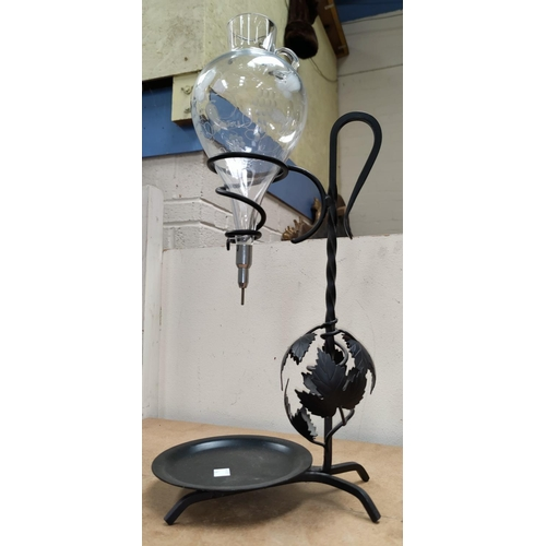 36 - A glass and metal wine fountain; 2 loving cups
