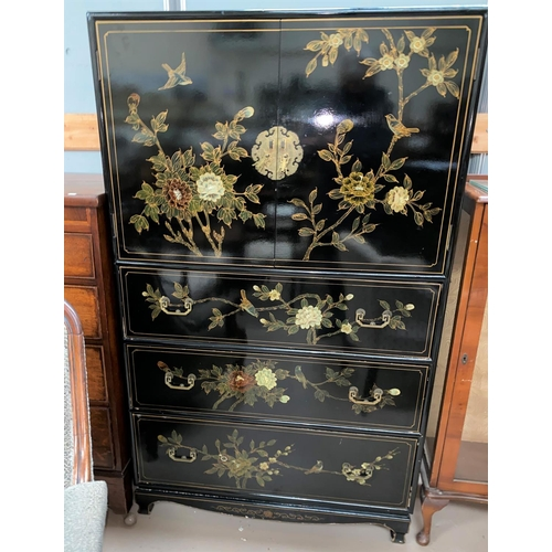 497 - A 20th century black lacquer Chinese style side cabinet with cupboard above and 3 drawers below deco...