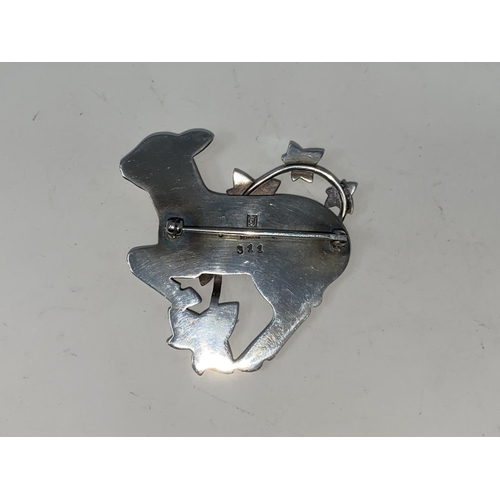 276 - Georg Jensen:  a silver brooch designed by Arno Malinowski, gambolling lamb with ivy overlay, stampe...