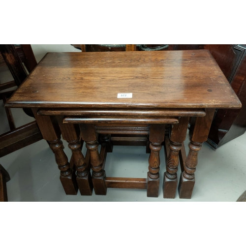 572 - An old charm nest of three oak occasional tables on turned legs....