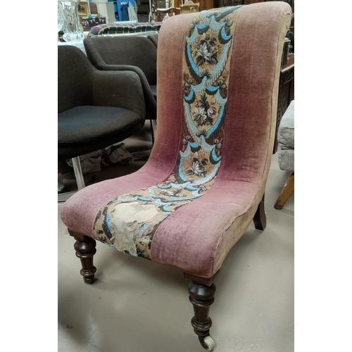 574 - A Victorian scoop back nursing chair with central beaded decoration, on turned legs....
