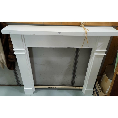 15 - A painted wooden fireplace surround