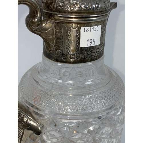 195 - An Edwardian cut glass claret jug with hallmarked silver chased lid, collar and handle, London 1903...