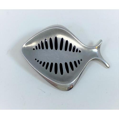 419 - A Georg Jensen brooch designed by Hennig Koppel, amodernist fish with black enamel markings, impress...