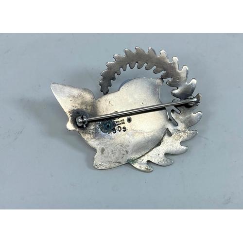 419A - A Georg Jensen silver brooch designed by Arno Malinowski, wren perching on a frond of fern, impresse...