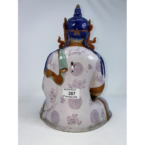 287 - A Chinese ceramic figure of a seated buddha in Lots position, height 30cm...
