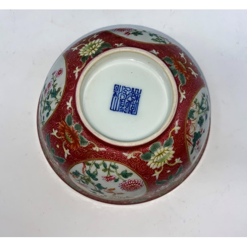 269 - A Chinese famille rose bowl with floral panel decoration to the outer and blue and white interior, m...