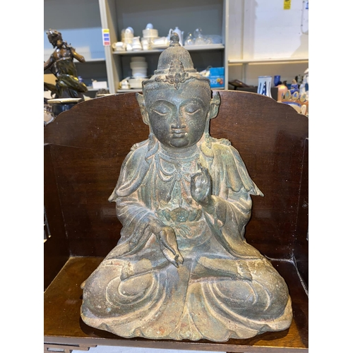 288 - A Chinese cast metal figure of a Buddha seated in Lotus position, height 31cm (interior filled); 2 b...