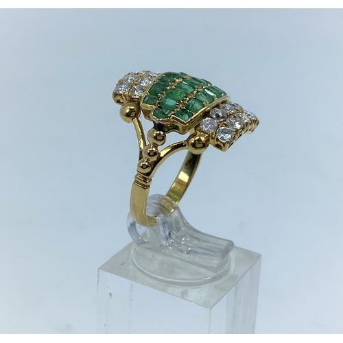 361 - A 1970's diamond and emerald dress ring with 4 rows of 5 diamonds and 3 rows of emeralds, shank 22 c...
