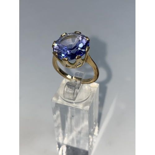 365 - A lady's yellow metal dress ring set with a large circular Tanzanite, unmarked but tests as 9ct, siz...