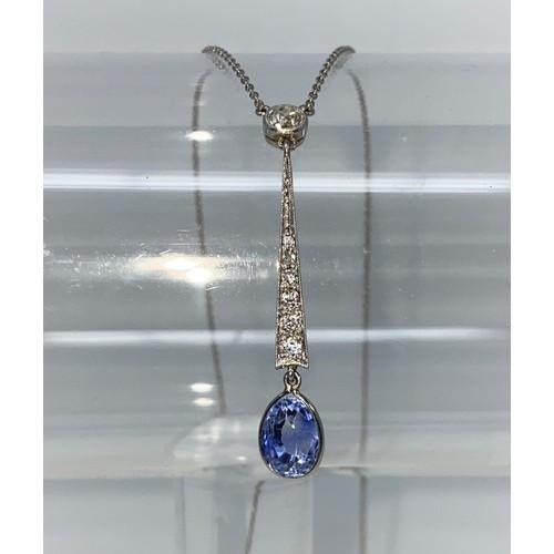 360C - An Art Deco white metal drop pendant with six graduating diamonds to the seam, a diamond to the top ...