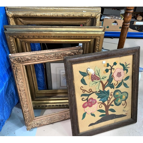 15 - A needlework firescreen and similar picture; 3 heavy gilt picture frames & a standard lamp...