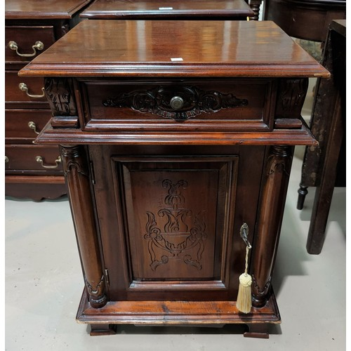 609 - A reproduction pair of dwarf chests of drawers in mahogany; a similar cabinet