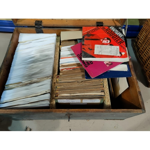 27 - A large collection of mid/late 20th century single records contained in a wooden box...