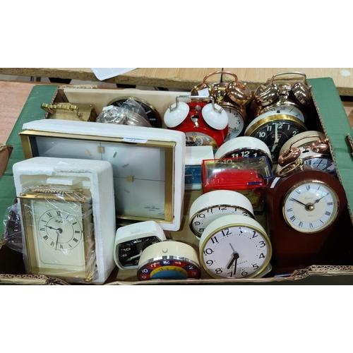 31 - A large selection of unused mantel/alarm clocks...