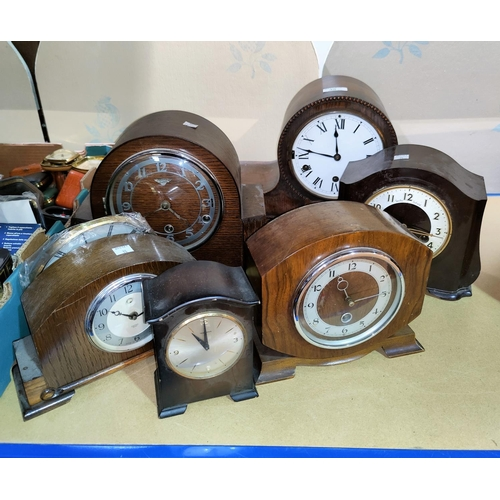 35 - Six 1930's mantel clocks in oak and stained wood cases...