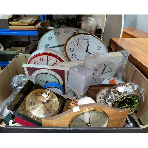 38 - A large wall clock; other wall, alarm and mantel clocks; etc....