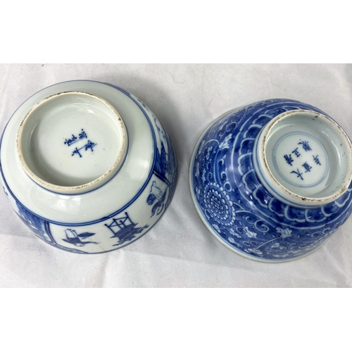 201 - A 19th century Chinese rice bowl decorated with chrysanthemums, etc., in blue and white, 6 character...