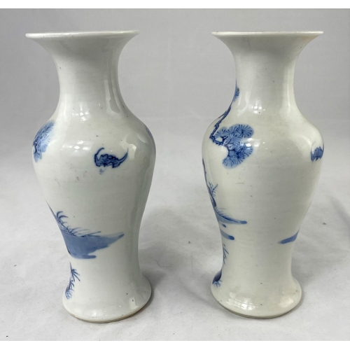 202 - A 19th century Chinese pair of inverted baluster vases decorated in blue and white with female figur...