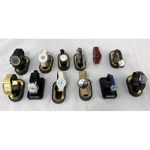 33 - A large selection of unused travelling alarm clocks and Sekonda watches...