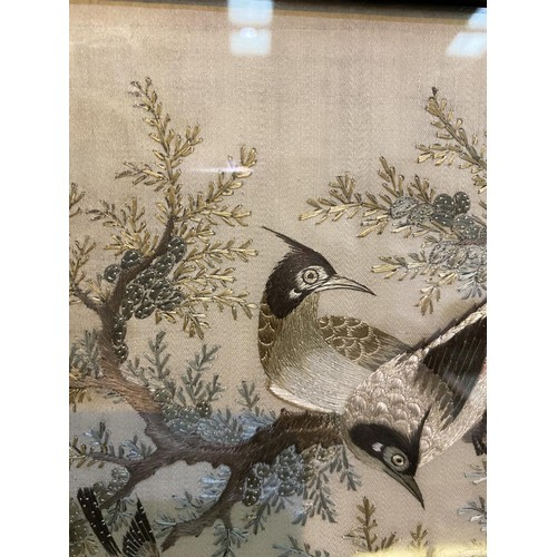 180 - A Chinese finely woven silk embroidery depicting pairs of exotic birds in carved and pierced hardwoo...