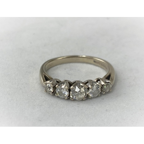 293 - An 18ct white metal 5 diamond set dress ring with larger central diamond with two graduating diamond...