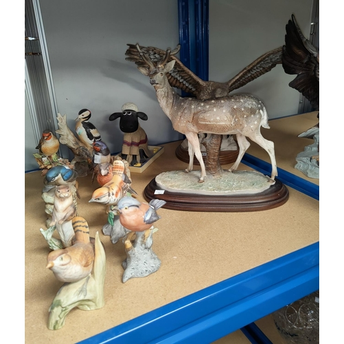 13 - A resin deer and eagle; a selection of bisque animals and birds...