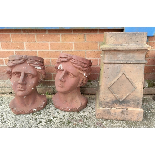 2 - A chimney pot and two large resin planters in the form of heads...