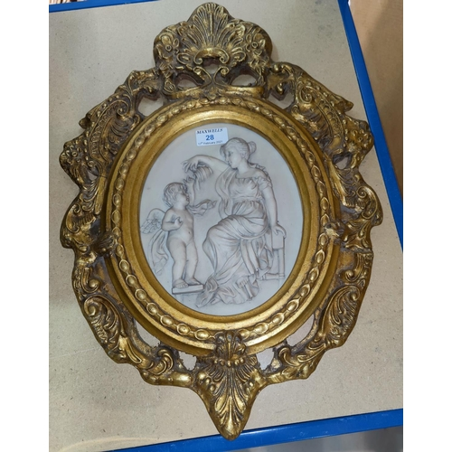 28 - A reproduction relief wall plaque, woman and cherub, in ornate gilt frame...