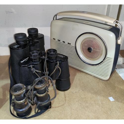 32 - Three sets of binoculars and a vintage Bush radio...