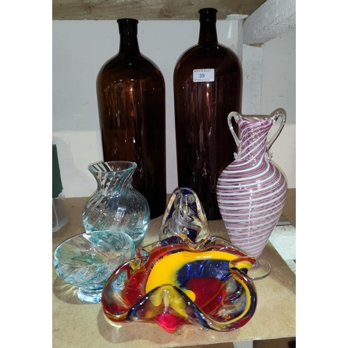 39 - Two amber glass chemist style bottles, ht 40 and 37cm, other coloured glassware...